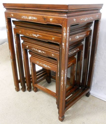 Nest of Four Oriental Polished Teak Coffee Tables